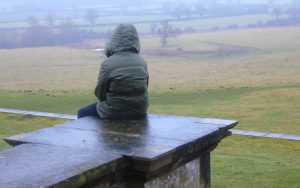 Girl sitting in the rain